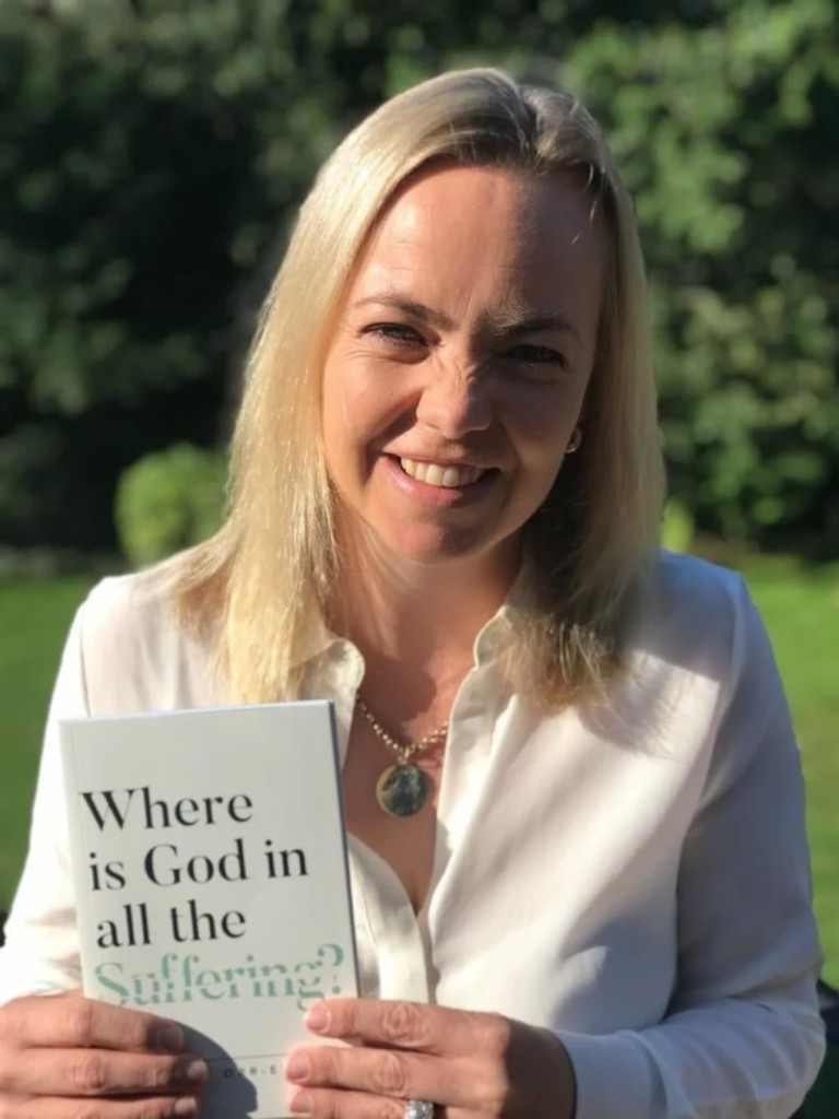 dr amy orr-ewing holds a copy of the book where is god in all the suffering?